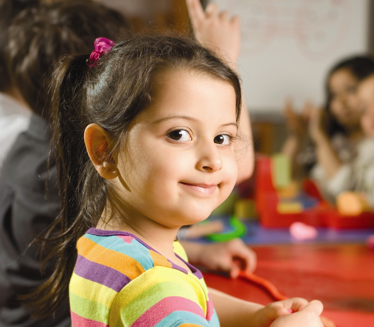 young smiling girl in child care center - Small Children Images